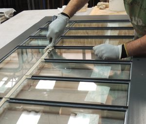 Casement window being hand-puttied